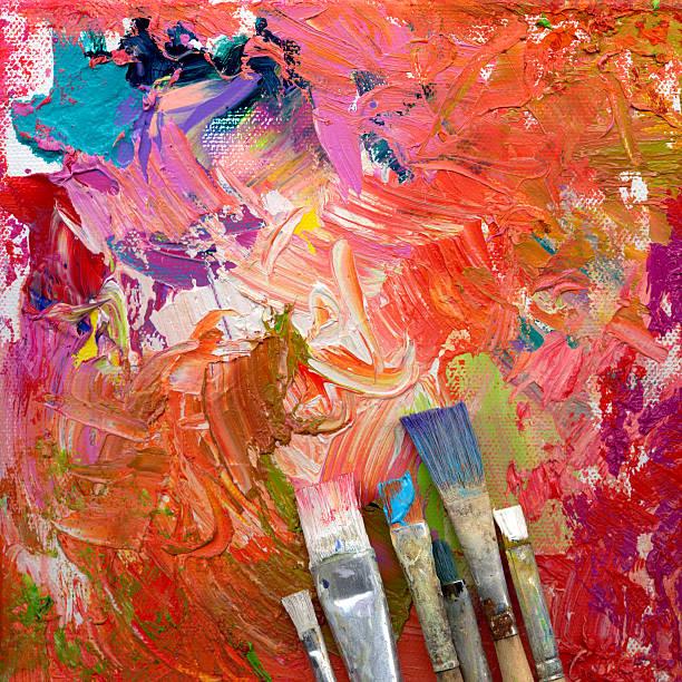 paint brushes lying on artwork - tuval üzerine akrilik stok fotoğraflar ve resimler