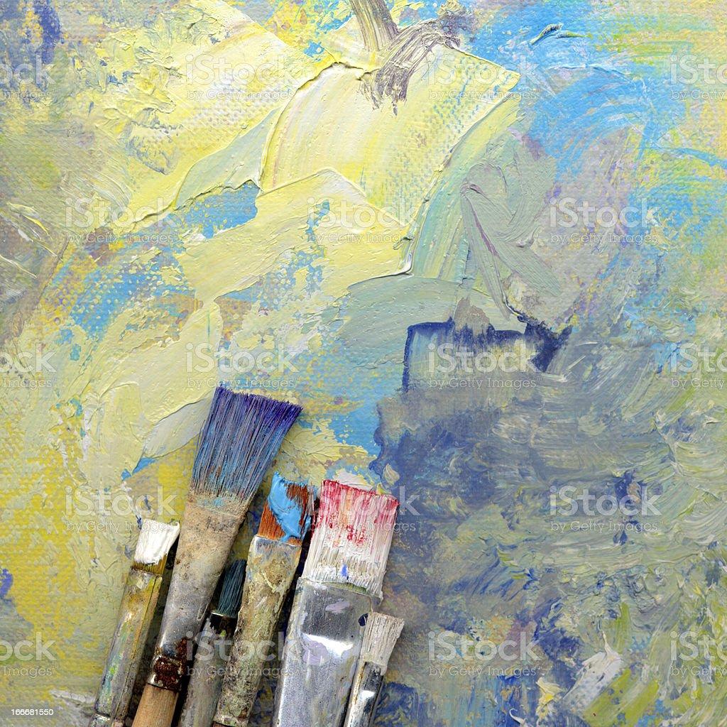 paint brushes lying on artwork royalty-free stock photo
