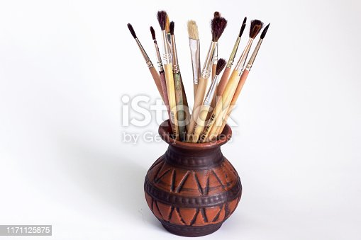 istock Paint brushes on a white background. Artist brushes 1171125875