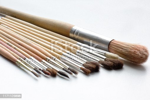 istock Paint brushes on a white background. Artist brushes 1171125898