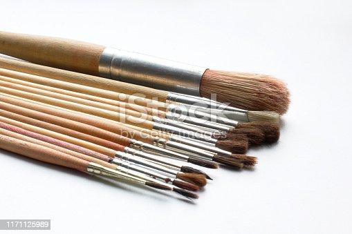 937983086 istock photo Paint brushes on a white background. Artist brushes 1171125989