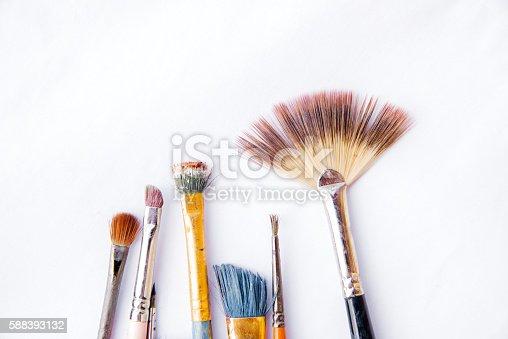 istock Paint brushes  on white background 588393132