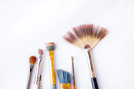 Dirty, old  paintbrushes isolated on white background, Used Paint Brushes