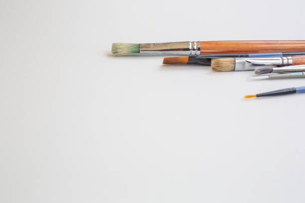 Paint brushes on white background with copy space, no people, horizontal layout stock photo