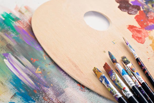 paint brushes, palette and artwork - acrylic painting stock photos and pictures