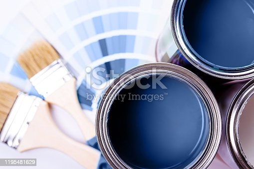 istock Paint brushes placed on top of can filled with blue paint. Classic blue color of year 2020. 1195481629