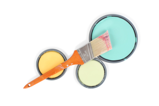 Colorful paint can lids with paint brush. Beautiful contemporary designer colors. Isolated on White with clipping path included.