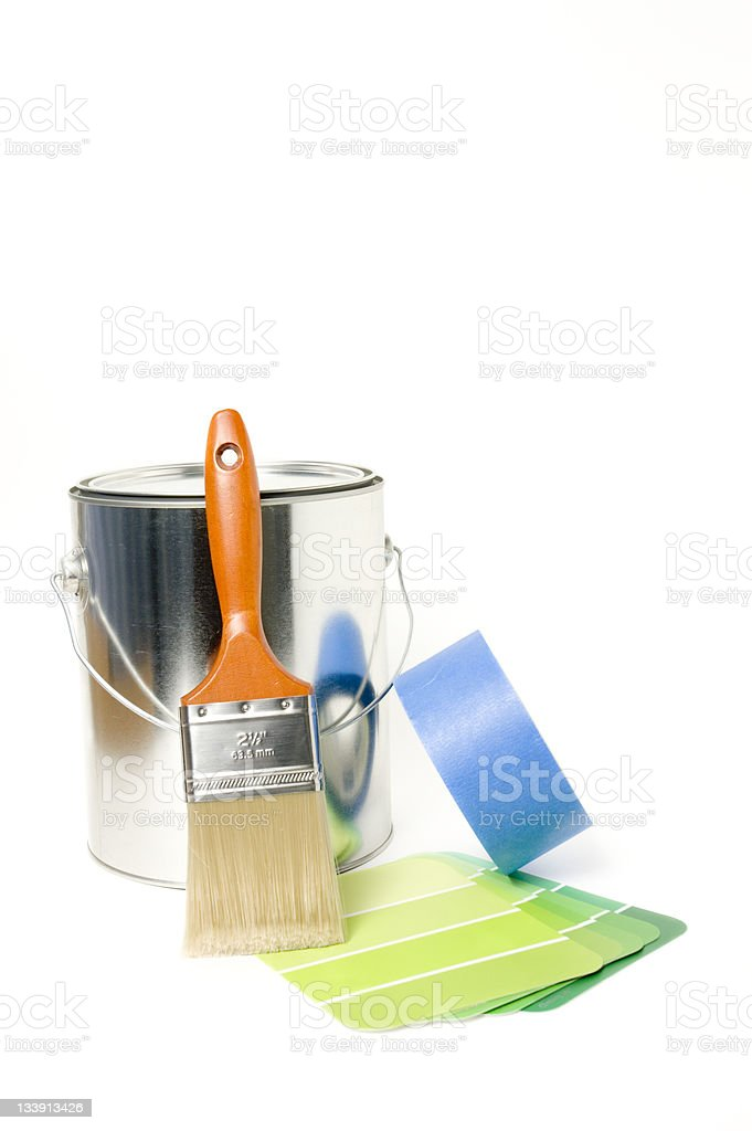 Paint can, paint brush, tape, and a green color palette stock photo