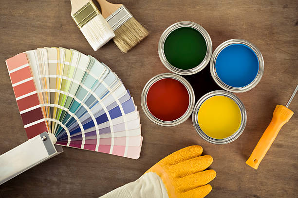 Paint cans and color chart stock photo