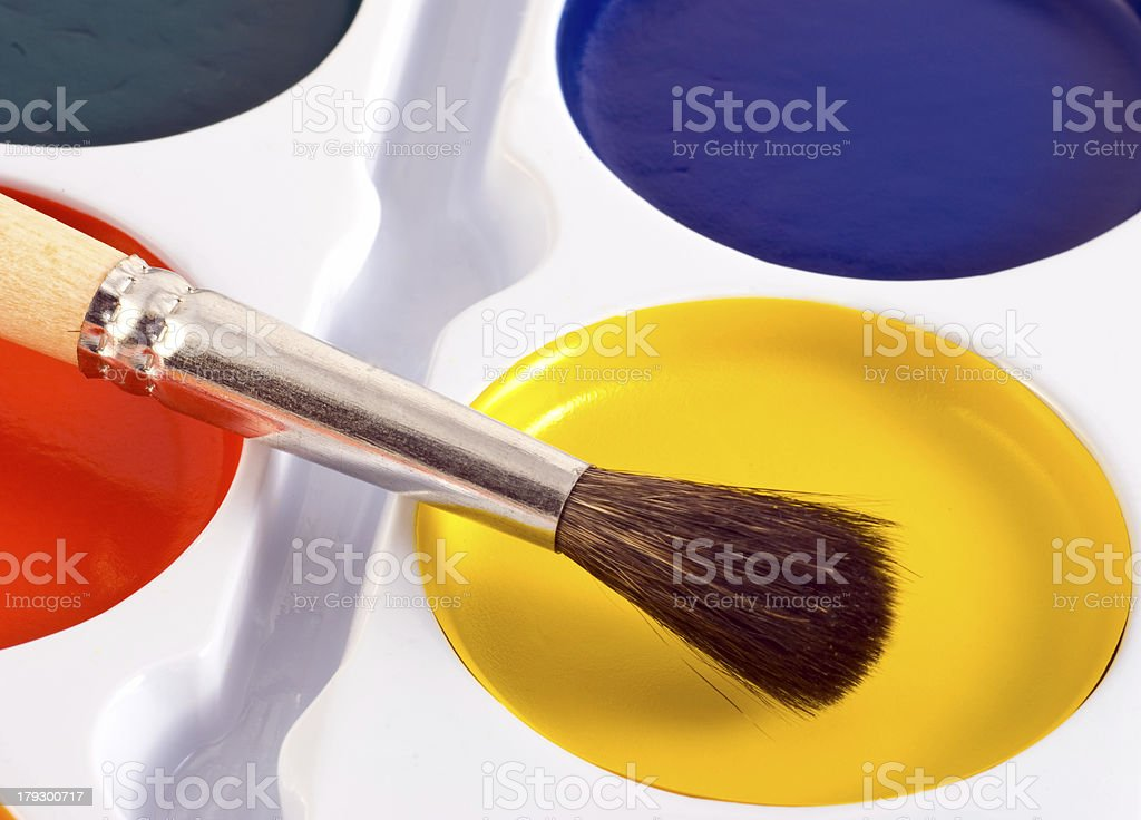 paint cans with one brush on top royalty-free stock photo