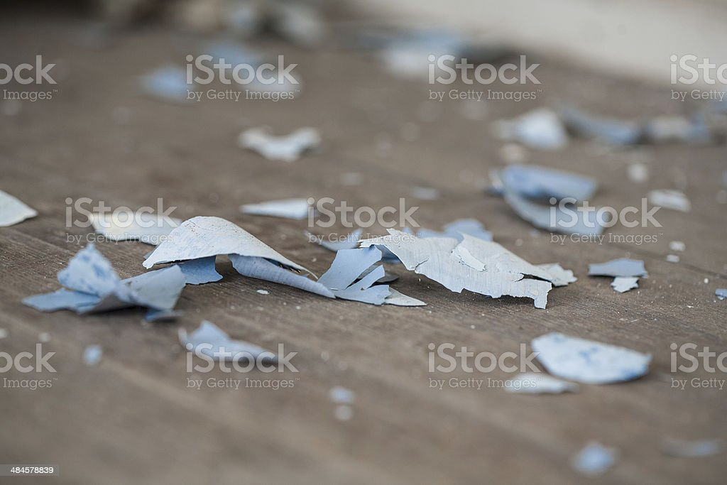 Paint chips on old hardwood floor stock photo