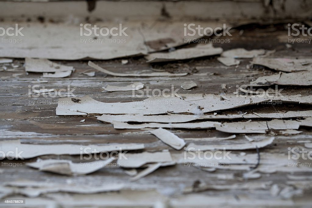 Paint chips on window seat in old home stock photo