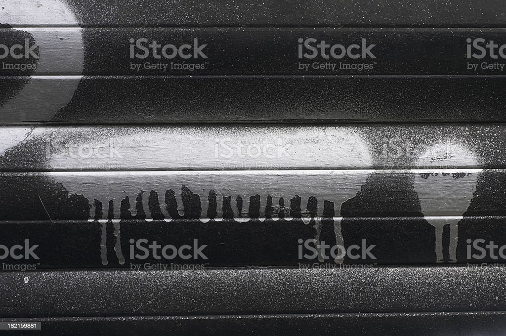Graffiti abstract silver paint dribbling down garage door stock photo