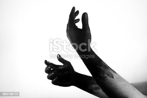 istock Paint hand black 905169722