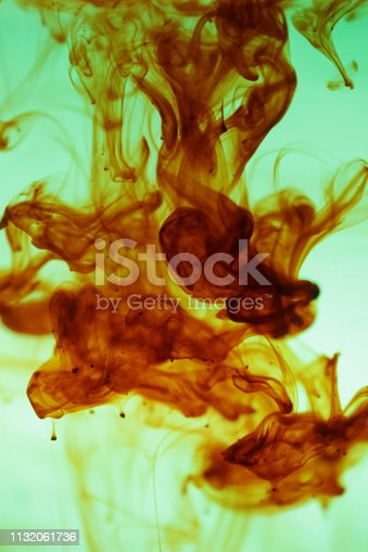 535193210 istock photo Paint in water background 1132061736