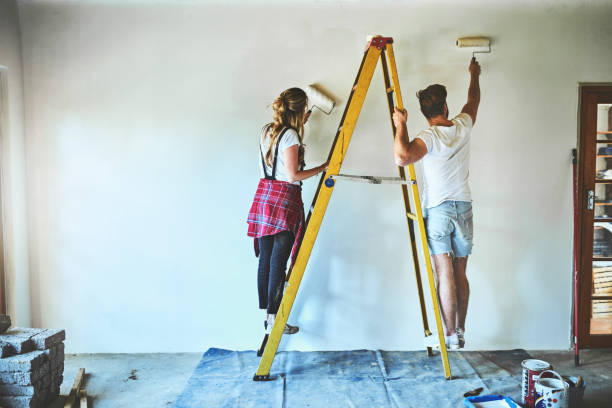 A paint job can make your house feel as good as new stock photo