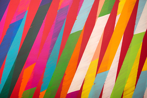 Paint on Canvas: Coloured Sections with Bright Shades.