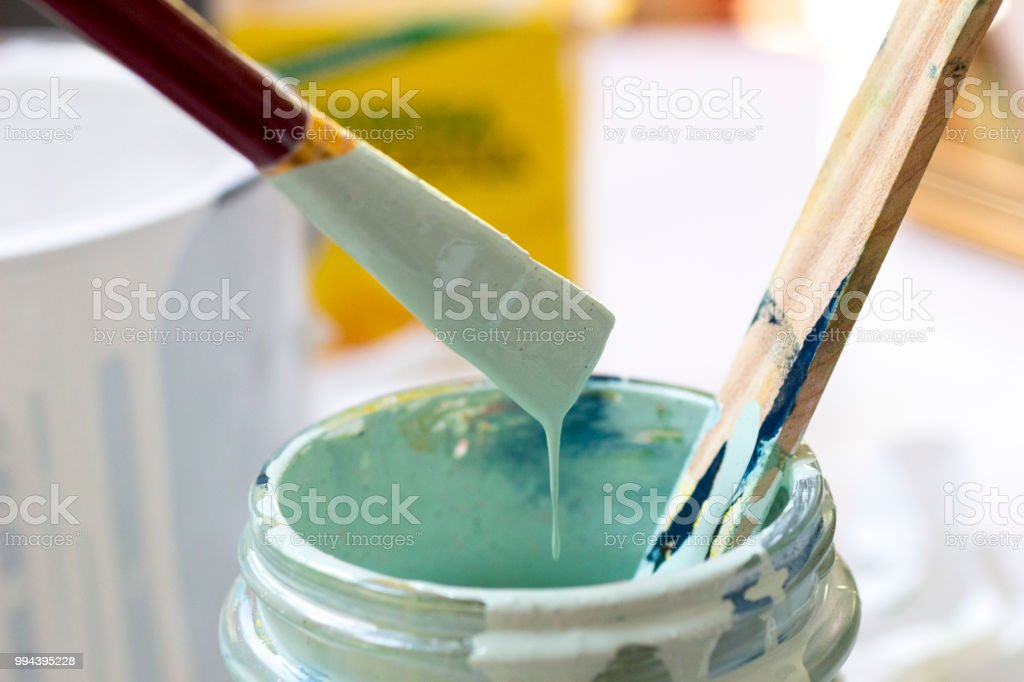 Paint, paintbrush and paintcan stock photo