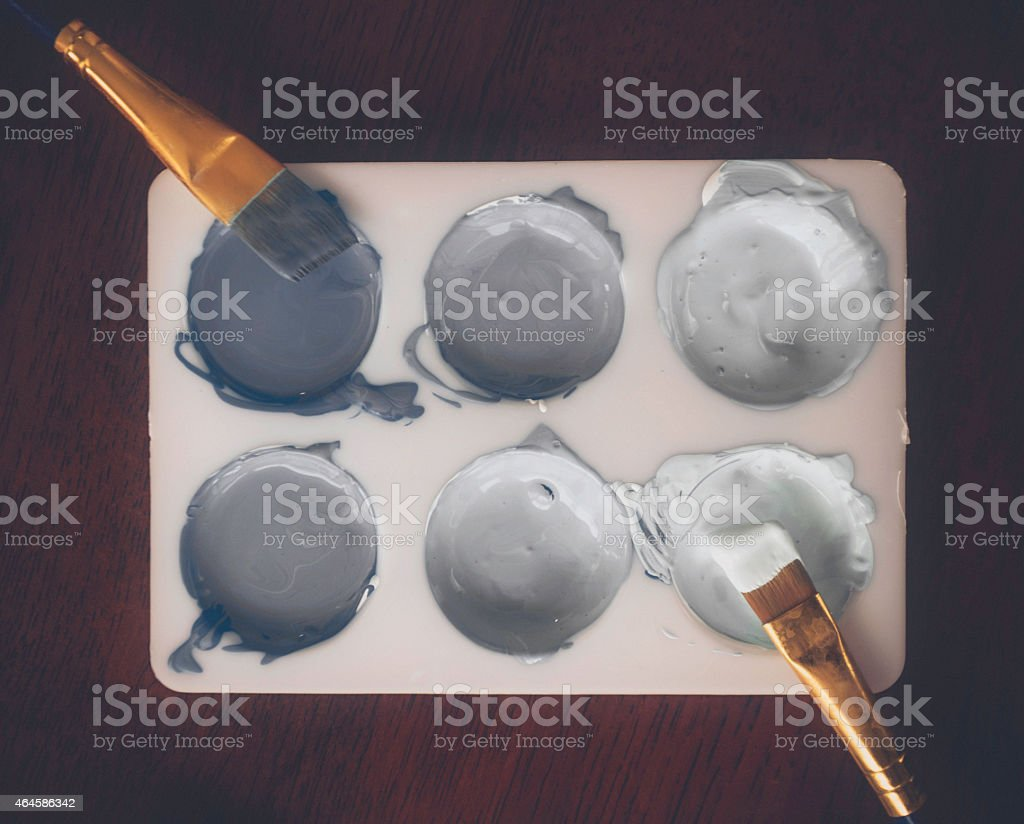 Paint palette with paint colors in various shades of gray stock photo