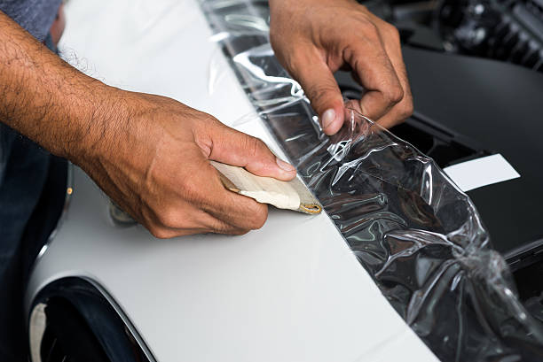 Paint protection film series : Installing paint protection film stock photo