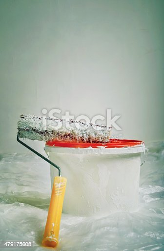 475744392 istock photo Paint roller and bucket ready for use 479175608