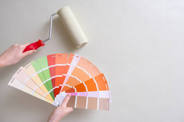 paint roller and color samples on paper stock photo