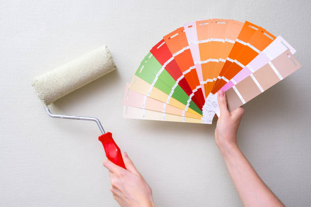 paint roller and color samples stock photo