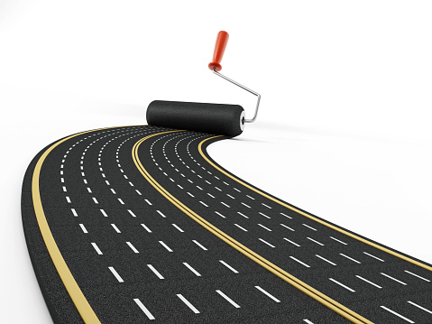 Paint roller drawing a multi lane motorway