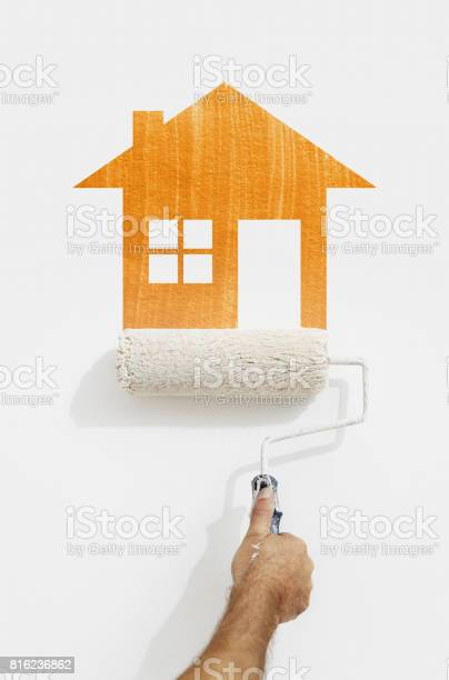 Paint roller hand with orange house symbol painting on wall isolated picture id816236862?b=1&k=6&m=816236862&s=612x612&h=qwptxqvciil8ltywz7etpddcf3y tzk5qwssasth 3q=