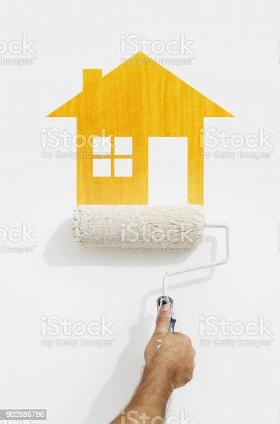 Paint roller hand with yellow house symbol painting on wall isolated picture id902886786?b=1&k=6&m=902886786&s=612x612&h=rx1uy8lxkh iqa0bcc pajwbodv2ebuibeuphxjbqey=