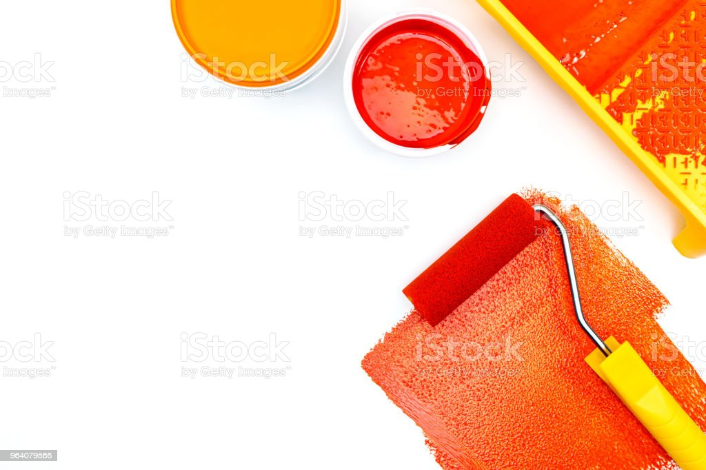 paint roller in red paint and paint tins on white background - Royalty-free Apartment Stock Photo