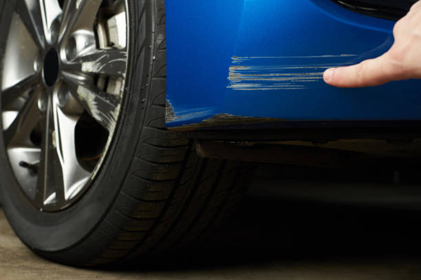Paint scratch on car Paint scratch on car. Insurance company checking car damage bumper stock pictures, royalty-free photos & images