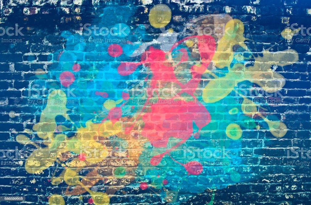 Paint splash on brick wall stock photo