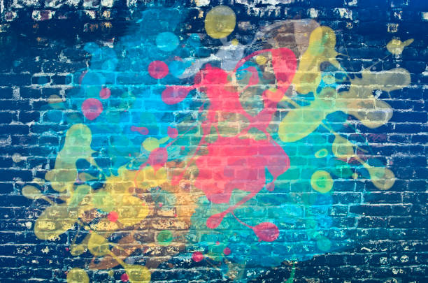 Paint splash on brick wall Paint splash on brick wall street art stock pictures, royalty-free photos & images