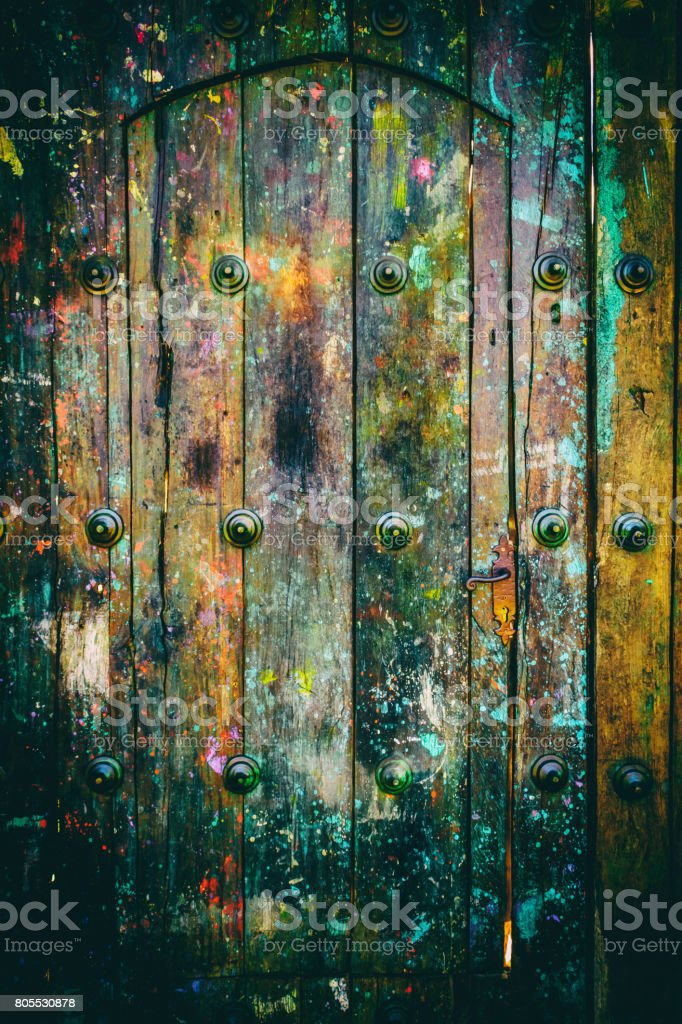 Paint splashes on weathered wooden door stock photo
