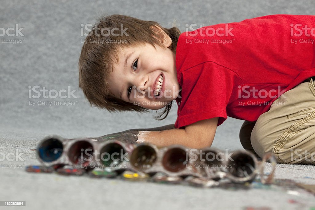 Paint stained boy. stock photo