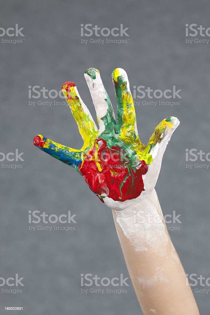 Paint stained kid's hand. stock photo
