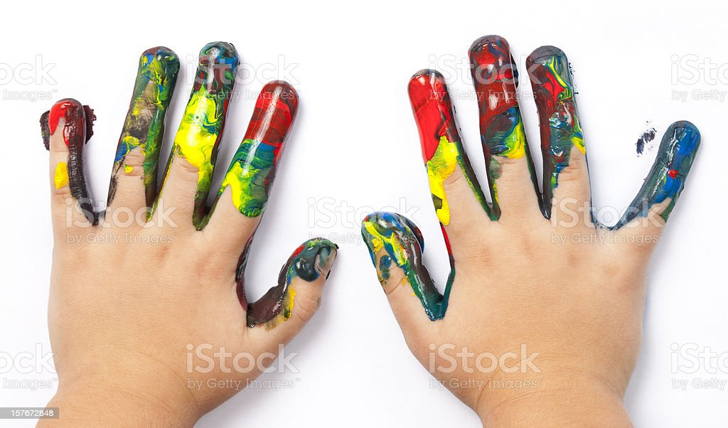 Paint stained kid's hands. stock photo