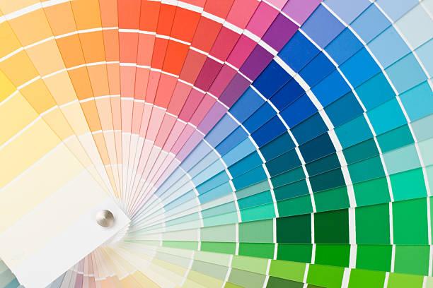paint swatches of many different colors - kleurenwaaier stockfoto's en -beelden