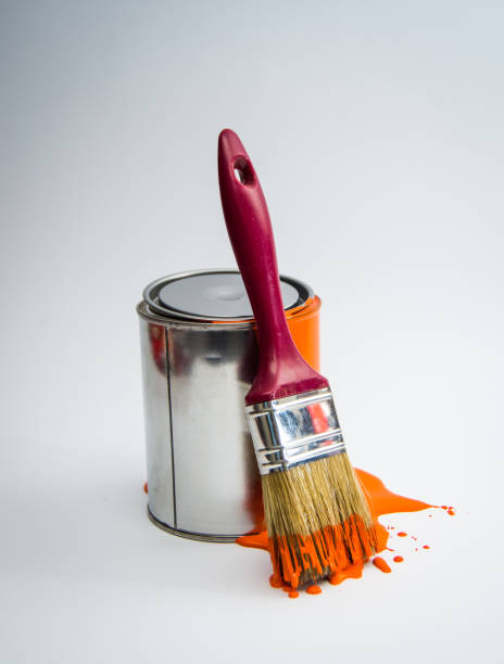 Paint tin can with paint brush,orange color stock photo