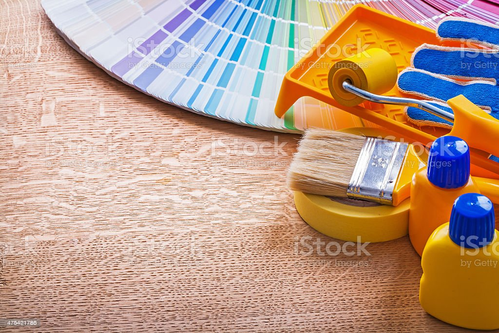 Paint tools and pantone color palette guide on wooden board stock photo