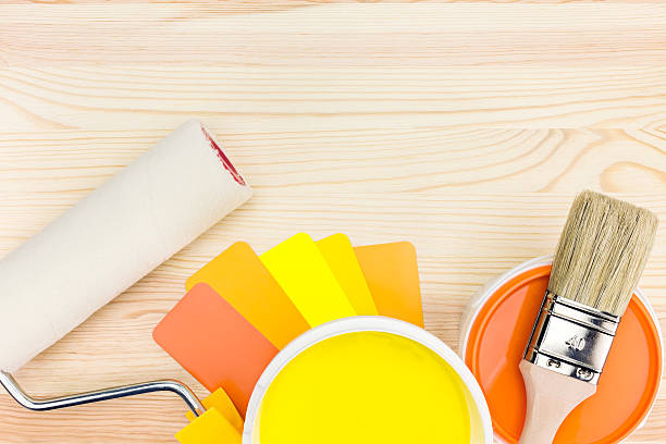 paint tools with color guide on wooden background stock photo