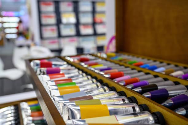 Paint tubes on display stock photo