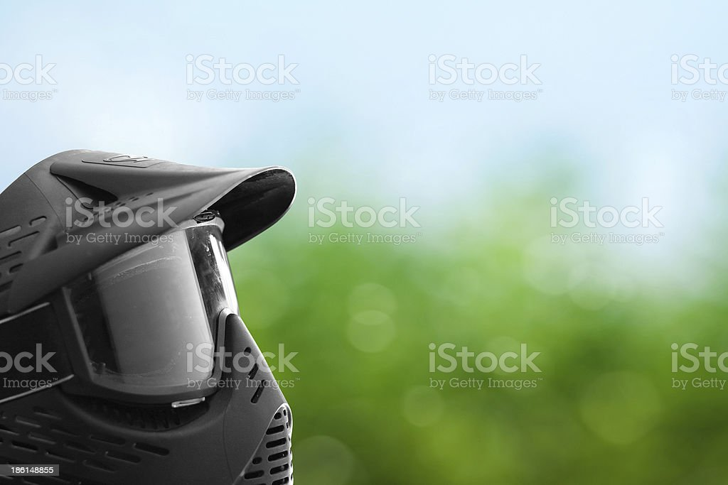 Paintball mask with green background stock photo