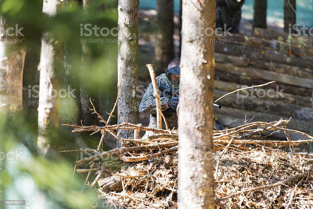 Paintball player Hiding stock photo