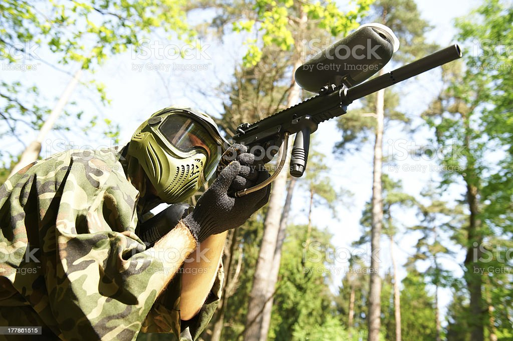 paintball player holding fire stock photo