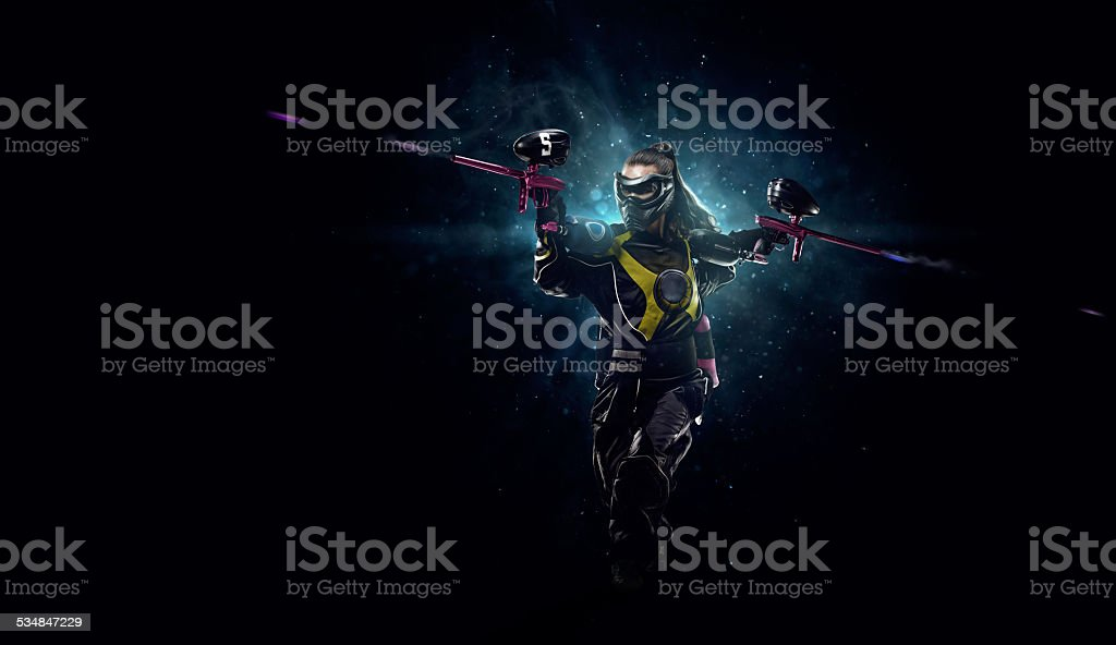 Paintball player is playing the game stock photo