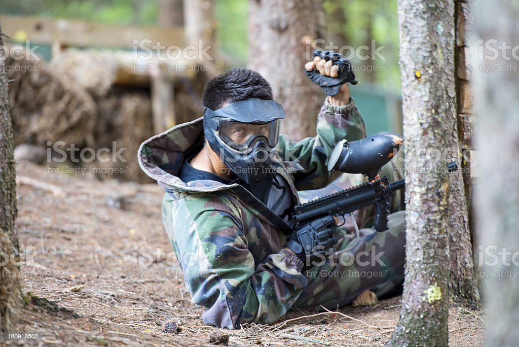 Paintball player Lying Down stock photo