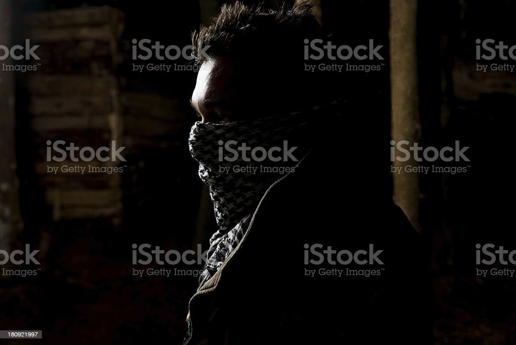 Paintball player posing for camera black background stock photo