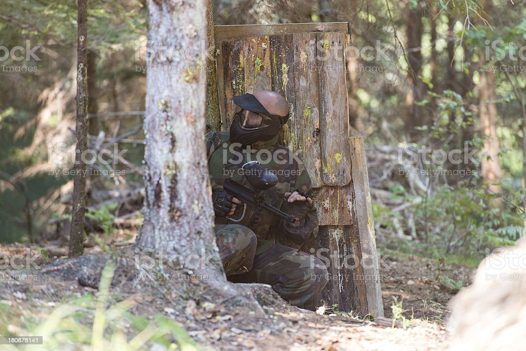 Paintball player wearing protecting mask royalty-free stock photo